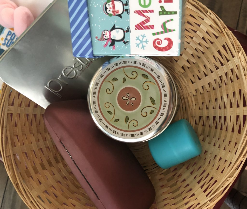 A Variety of containers with different opening mechanisms: a box, a tin, a plastic egg, an eyeglasses case